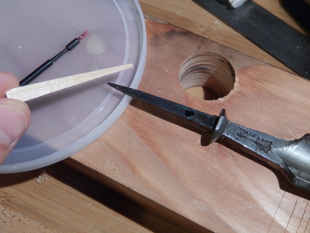A small amount of Fish glue is all that is needed to glue the shims to the steel. Make sure that the steel tang is clean before you glue the shims to it.