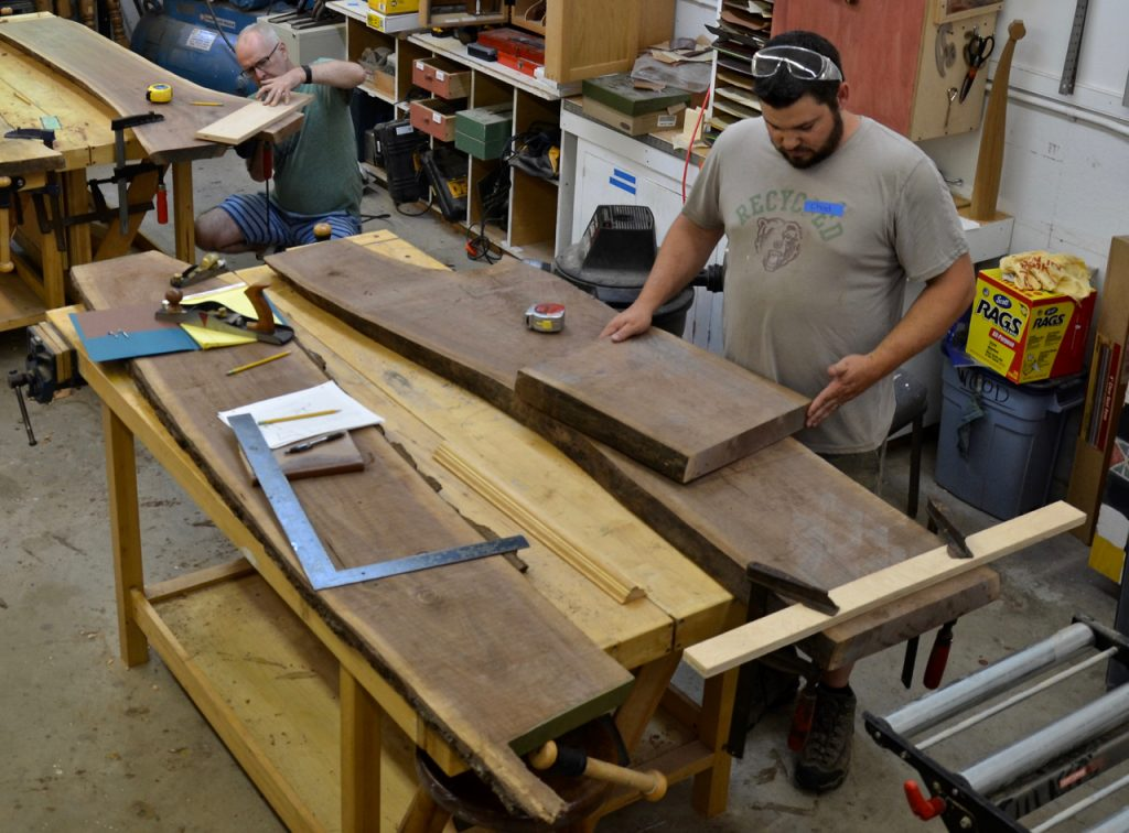 Using a circular saw guided by a makeshift track he began the work, crosscutting the more massive slab into three portions: top, and two portions to be the legs.