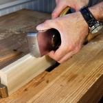 """Plane the middle. There is so much friction in assembling a sliding dovetail that it's best to hollow out the middle of the joint with a few """"stopped shavings"""" along the joint's bevel."""
