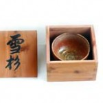 """Toshio named his tea-cup """"sezzai"""" (standing in snow) & made this box with aromatic Cedar; caligraphy was written by the known chisel maker Iyoroi. In this way Kato's tea cup was given a name, and placed into a paulownia box."""